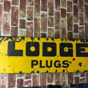 Vintage Lodge Plugs Enamel Sign